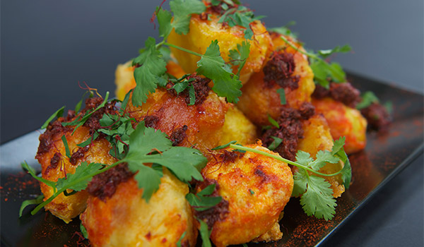 Roast Potatoes with Harissa and Coriander